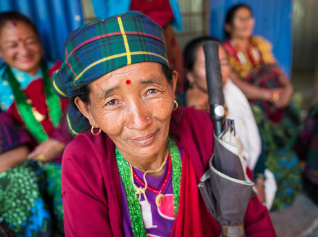 A community member attending the community meeting held at the rebuilt Jivanjyoti Lower Secondary School in the Gorkha District of Nepal.