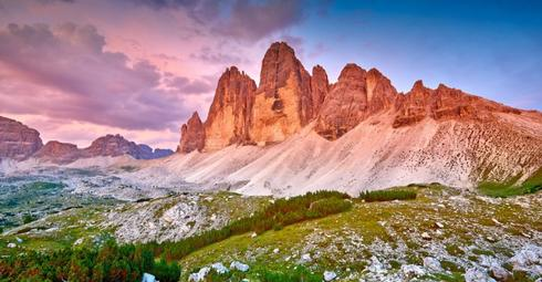 Amazing view of The Three Peaks of Lavaredo (Tre Cime di Lavaredo) at sunset. Trentino Alto Adidge, Dolomites mountains, South Tyrol, Italy, Europe.
