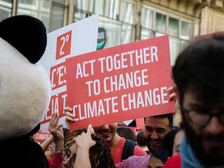 "Sign reading ""act together to change climate change"" from the 2018 Paris Climate March"