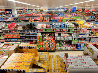 Aisles of fully-stocked shelves in a typical Western supermarket