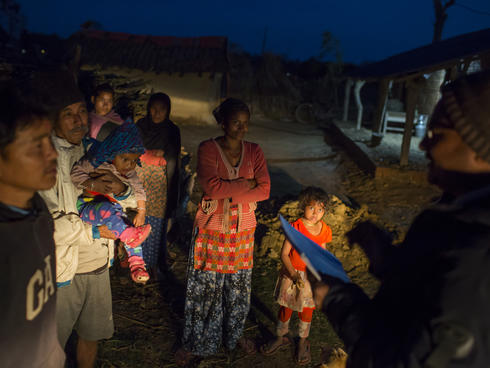 Rapid Response Team is arriving in a house to help villagers to deal with a wildlife conflict. Khata Corridor, Nepal.