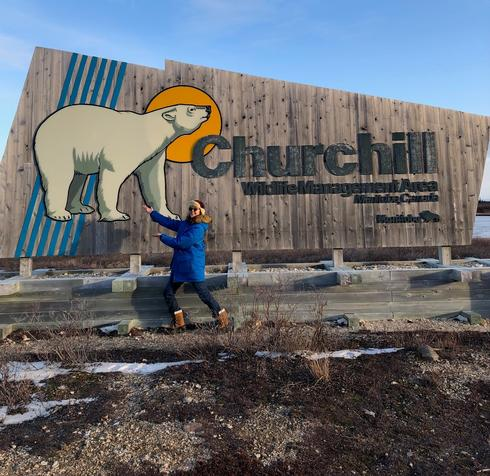King of the Arctic Legacy Circle Trip - Guide in front of Churchill Alaska sign