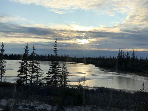 King of the Arctic Legacy Circle Trip - View of sunset from bus