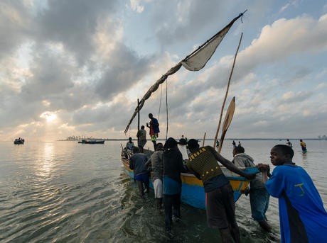 fisherman prepare for the days net fishing from their dow near Palma, Mozambique