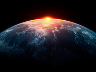 Image of sunlight eclipsing planet Earth