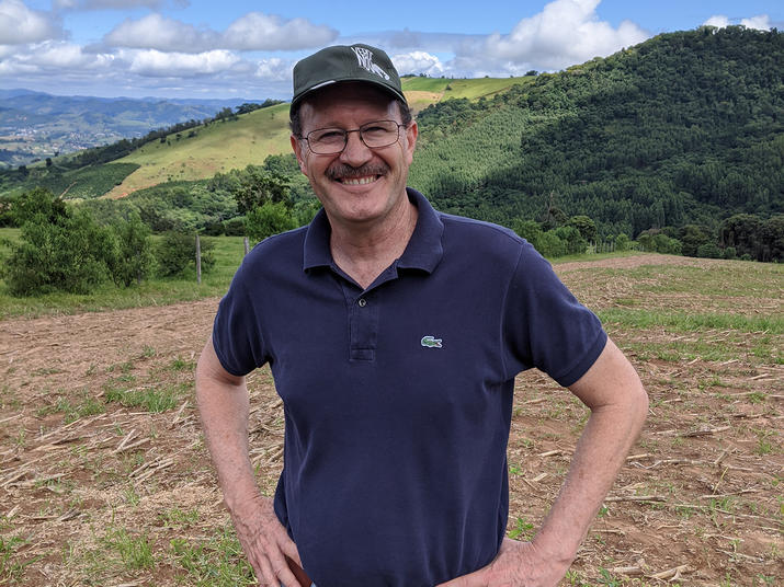 David Tassara in front of land that will be restored as part of the Raizes do Mogi Guaçu program