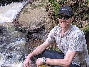 Matt Inbusch in front of a waterfall in the Atlantic Forest