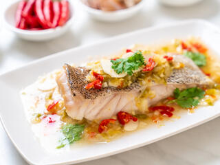 Steamed grouper fish filet with chili lime sauce in lime dressing