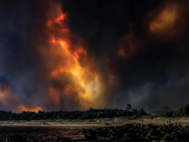 Landscape with dark smoke filling sky