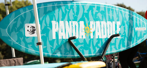 Surfboard with custom Panda Paddle design