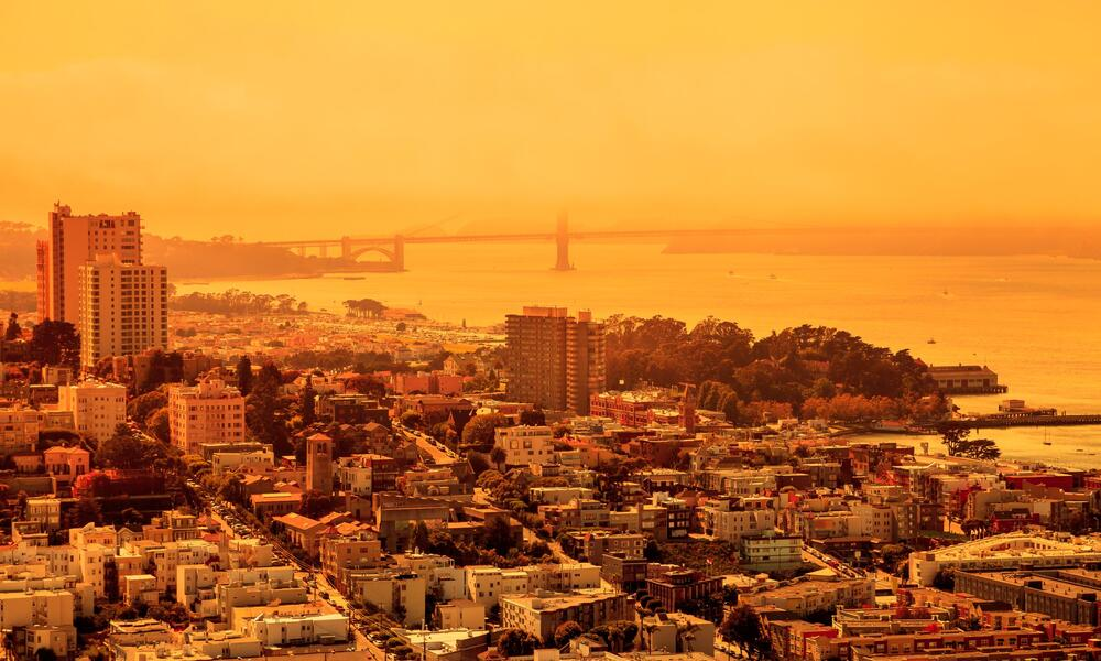 Buildings surrounded in an orange glow.