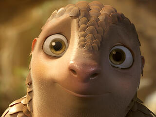 Cartoon character Lin the Pangolin pleading at the camera to help him.