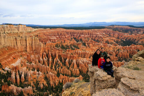 Family portrait with canyons in the background