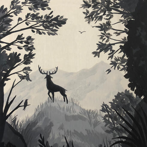 Silhouette of deer on hill with trees