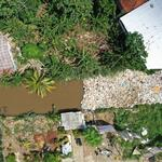 Aerial photo of a river clogged by plastic waste