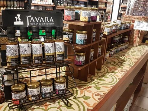 Jars of honey in a display case on a table in a store