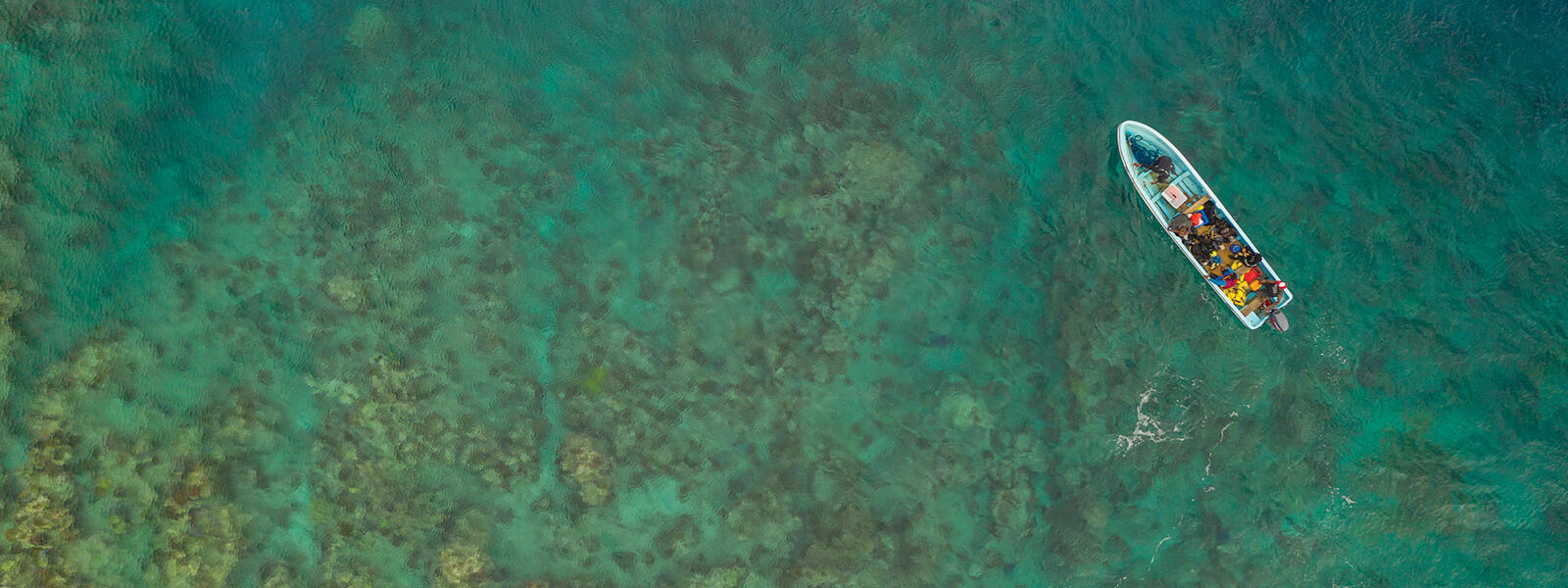 A diving skiff about to anchor at a reef north of Vanua Levu, Fiji
