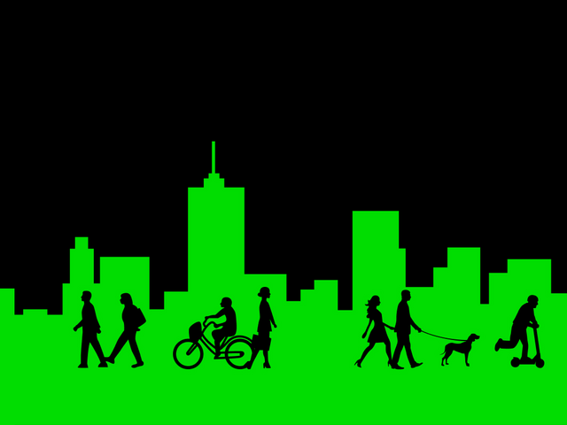 City skyline with pedestrians and riders