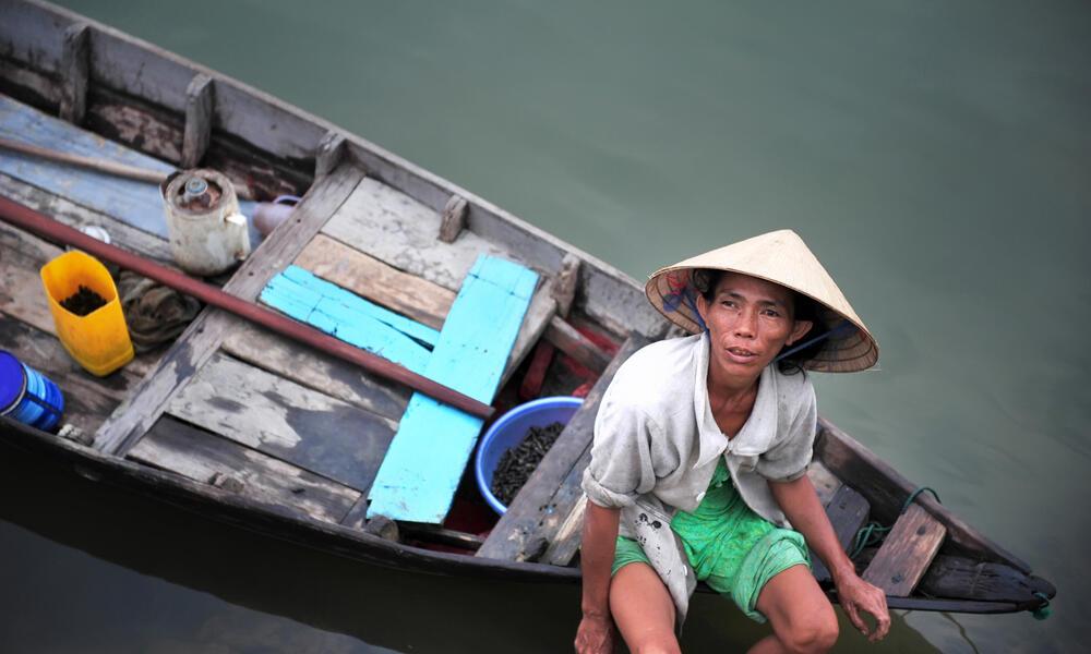 Vietnamese fisherman on boat