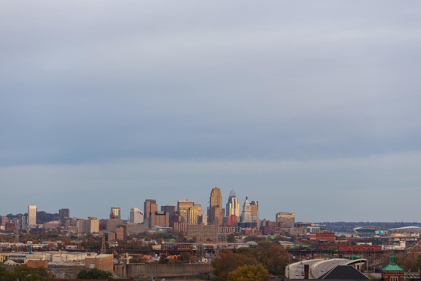 Skyline of the city of Cincinnati against a cloudy sky.