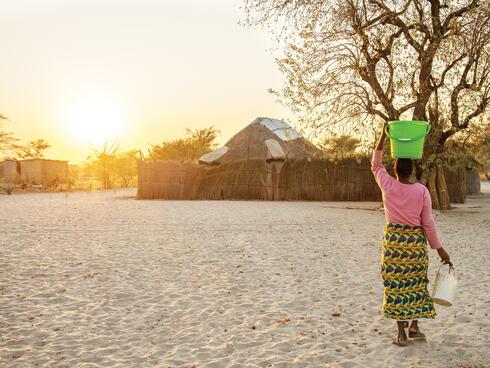 Woman walking in Namibian village