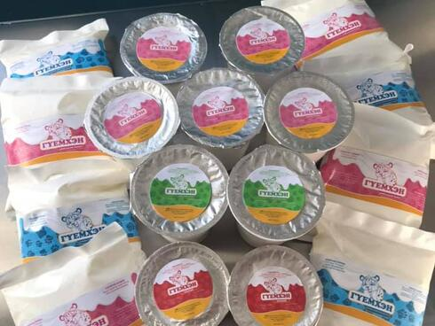 A pile of Mongolian yak dairy products in plastic pink and blue packaging