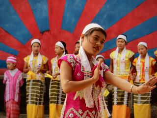 Community members in Souther Myanmar participate in a Karen traditional dance
