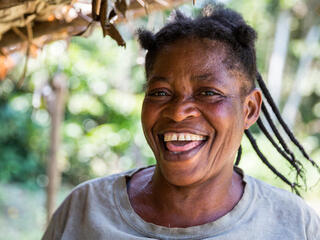 Marie Louise Banyanga, who owns model farm in Mankato, Democratic Republic of the Congo smiles at the camera