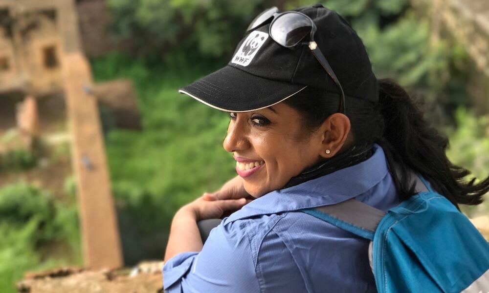 Nilanga Jayasinghe overlooks a sandy knoll