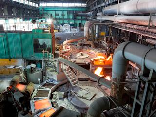 Machinery inside a blast furnace with very hot materials