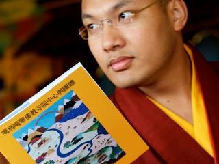 Tibetan Monk reads a copy of the Khoryug