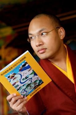 Tibetan Monk reads a copy of the Khoryug
