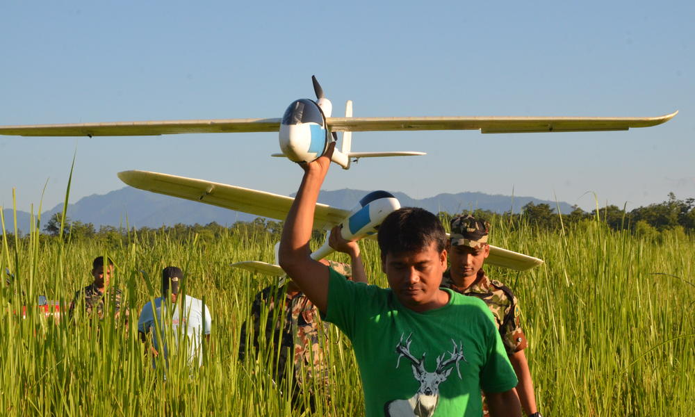 Park rangers in Nepal carrying UAVs
