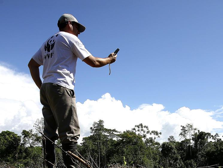 WWF-Peru staff and GPS reading, Peru