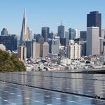 Solar panels in front of San Francisco skyline