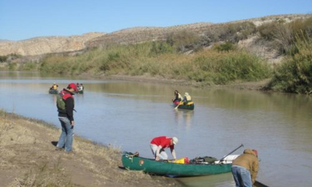 People canoeing down Rio Grande