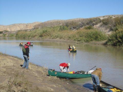 People canoeing down Rio Grande