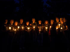Earth Hour participants holding candles