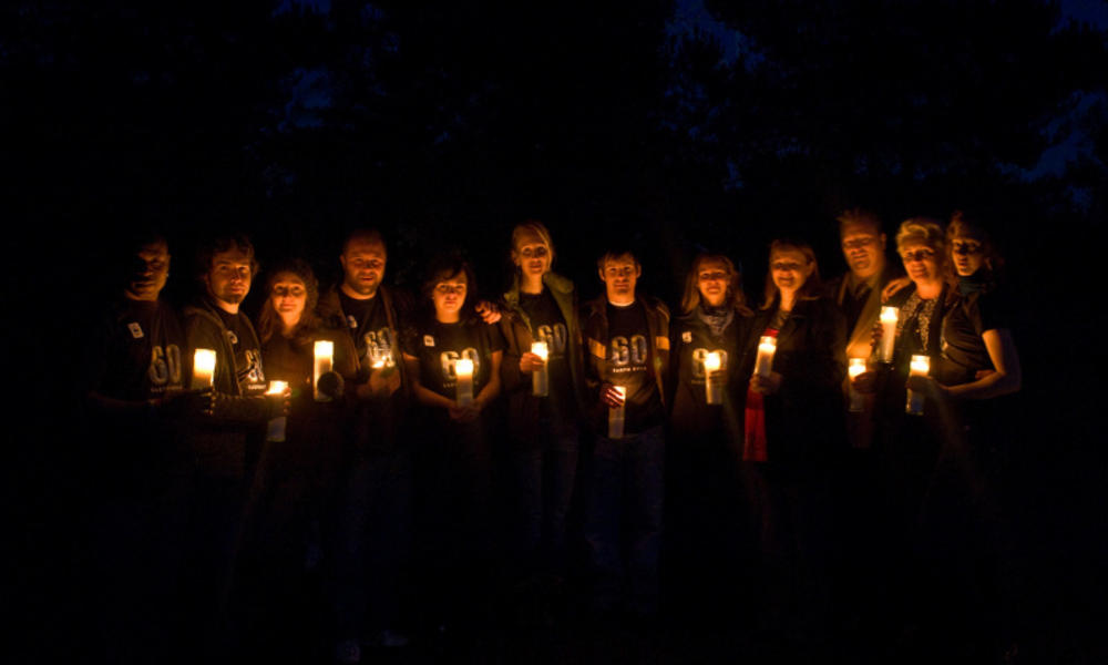 People holding candles during earth hour