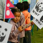 A Nepali child celebrating WWF-Nepal's 20th anniversary