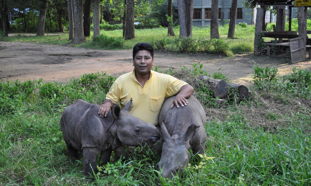 Rupak maharjan with two rhino calfs