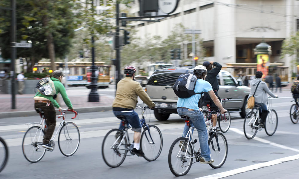 Cyclists in traffic in San Francisco, California