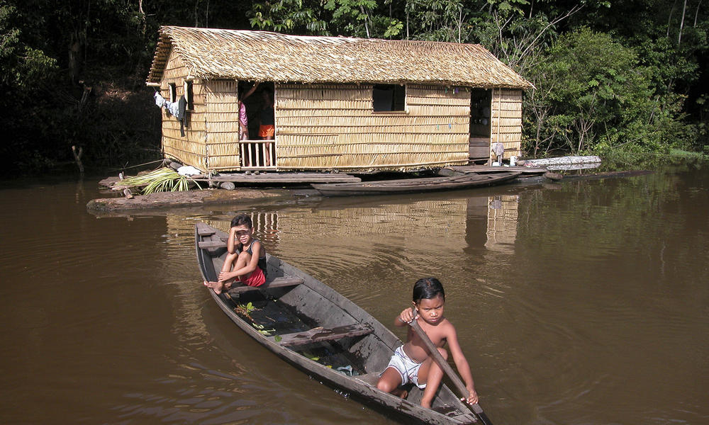 children in canoe in Amazon