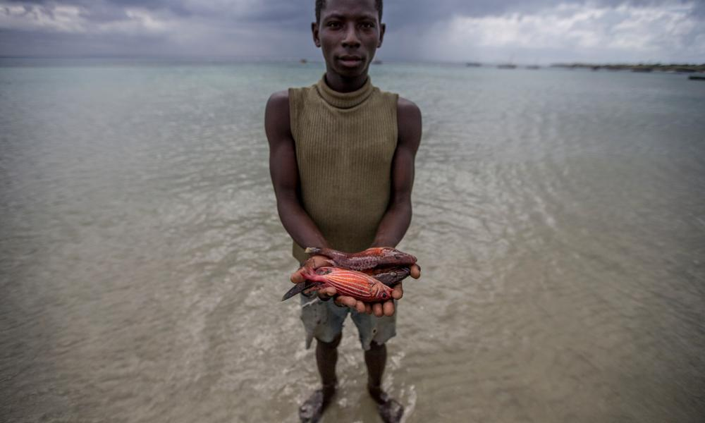 A Nuarro fisher shows off his catch