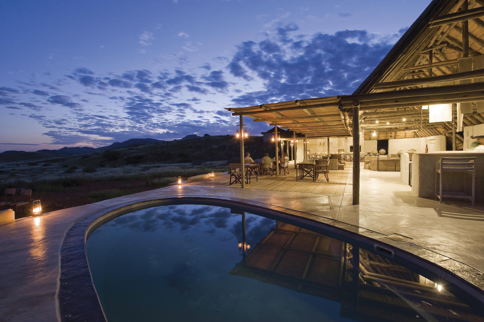Damaraland camp pool at sunset %28c%29 dana allen