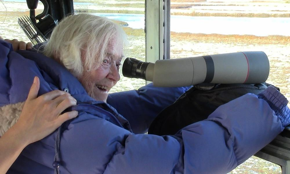 Elsa Bailey viewing polar bears through a telescope