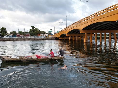 Men in a boat in Honduras