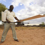 A Namibian ranger holds unmanned aerial vehicle during a training