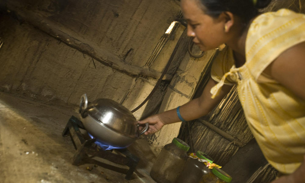 Kinu Darai cooking with bio-gas in her family home.