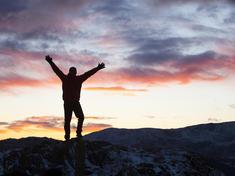 Mountain climber at sunset